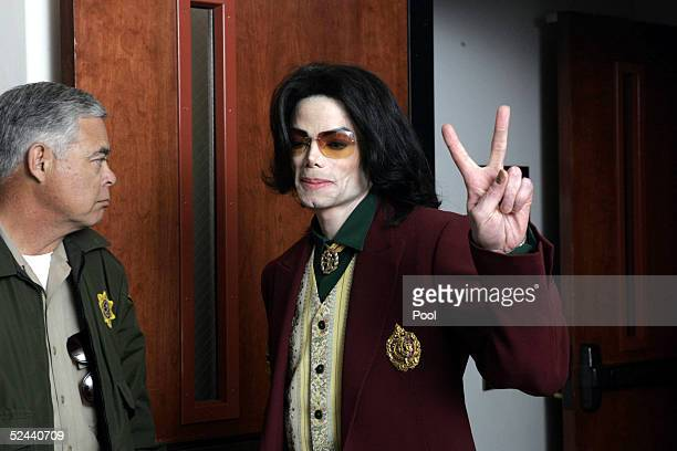 Singer Michael Jackson leaves the courtroom during a break in his child molestation trial at the Santa Barbara County Courthouse March 17 2005 in...