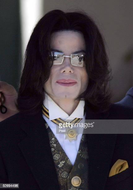 Singer Michael Jackson leaves the Santa Barbara County Courthouse April 25 2005 during his child molestation trial in Santa Maria California