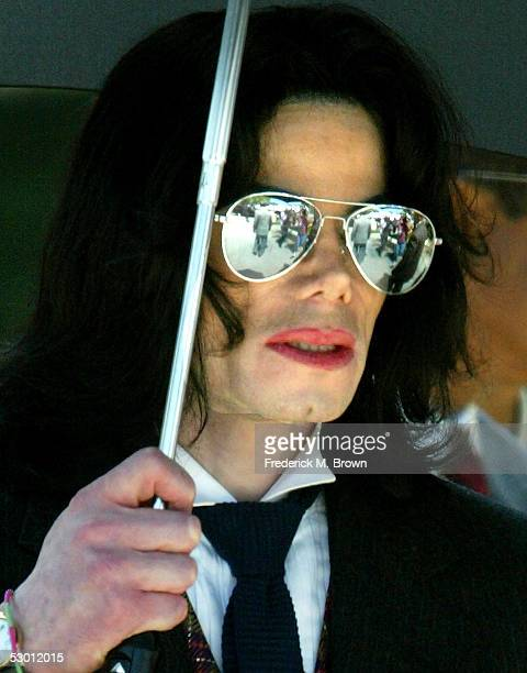 Singer Michael Jackson leaves the Santa Barbara County Courthouse after a day of closing arguments in his child molestation trial June 2 2005 in...
