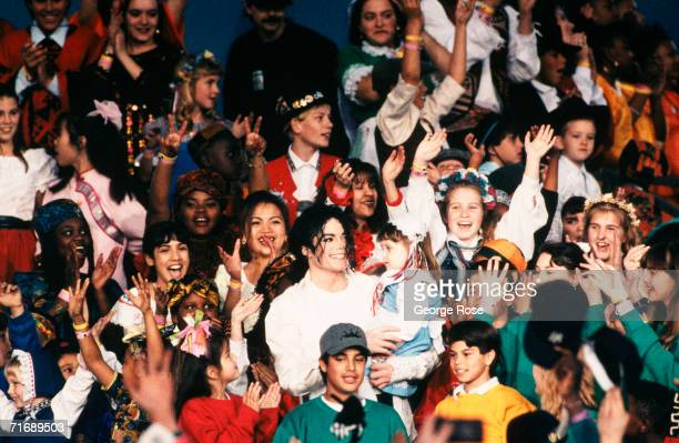 Singer Michael Jackson performs with hundreds of children at the 1993 Pasadena California Superbowl XXVII halftime show The King of Pop performed...