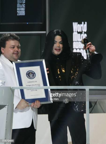Singer Michael Jackson receives the Diamond Award and a certificate for his 8 Guinness World Records during the 2006 World Music Awards at Earls...