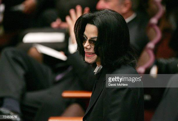 Singer Michael Jackson stands in the audience during the funeral services for lawyer Johnnie L Cochran Jr at the West Angeles Cathedral on April 6...