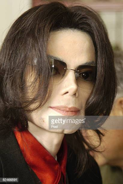 Singer Michael Jackson takes a break from his child molestation trial at the Santa Barbara County Courthouse March 22 2005 in Santa Maria California...
