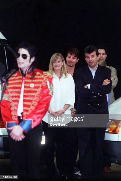 Singer Michael Jackson talks to fans as wife Debbie Rowe looks on on July 10 1997 in Sheffield England