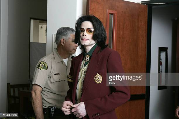 Singer Michael Jackson walks out of the courtroom during a break in his child molestation at the Santa Barbara County Courthouse March 17 2005 in...