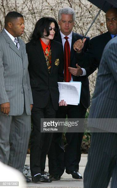 Singer Michael Jackson walks with attorneys and bodyguards as he leaves the Santa Barbara Superior courthouse February 14 2005 in Santa Maria...