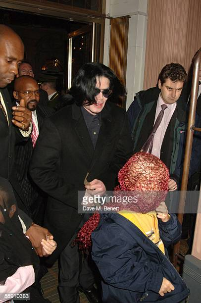 Singer Michael Jackson walks with his children Prince and Paris as they visit Harrods October 12 2005 in London England