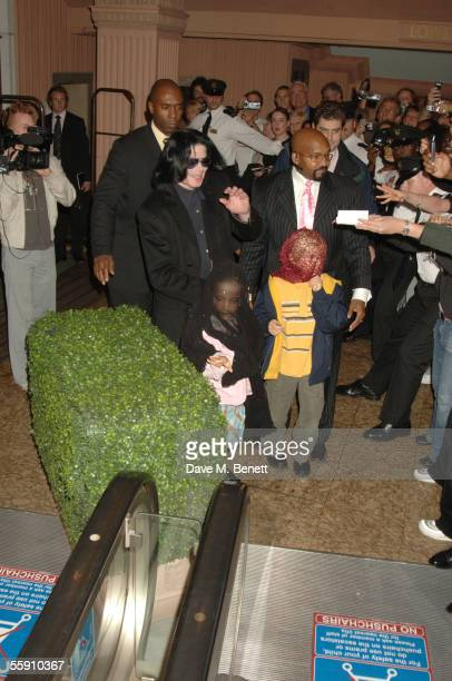 Singer Michael Jackson walks with his children, Prince and Paris, as fans stand nearby while they visit Harrods October 12, 2005 in London, England.