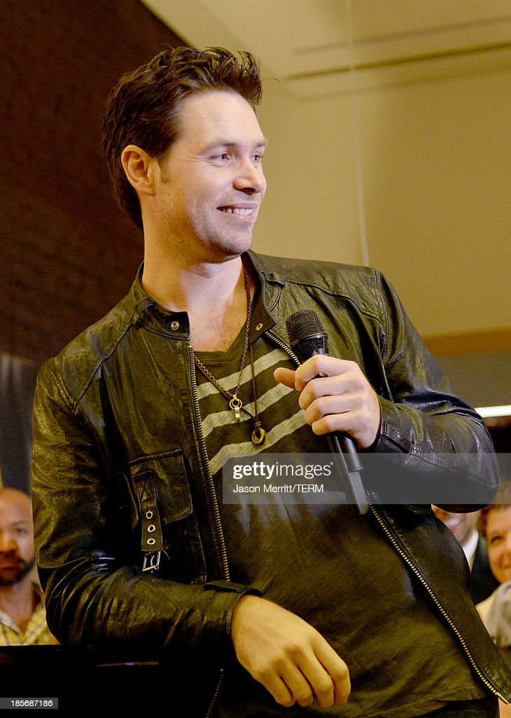Singer Michael Johns performs onstage to celebrate the opening of the new Nespresso Beverly Hills Flagship boutique on October 23, 2013 in Beverly Hills, California. The 7,500 square foot space offers guests the ultimate coffee experience.