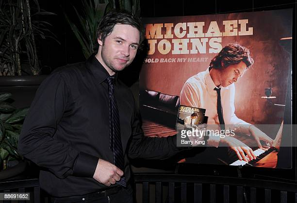 Singer Michael Johns signs his new CD at Hollywood and Highland on June 25 2009 in Hollywood California