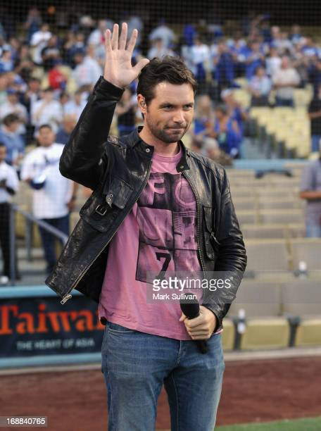 Singer Michael Johns sings the national anthem before the MLB game between the Los Angeles Dodgers and Washington Nationals at Dodger Stadium on May...