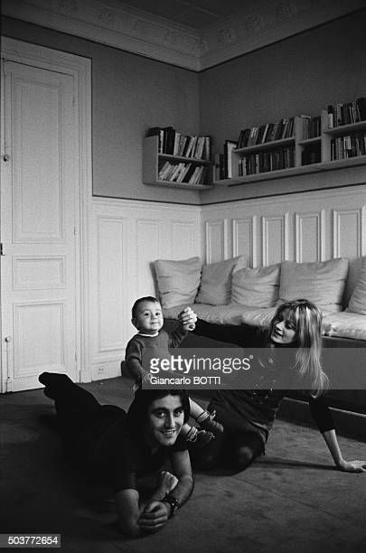 Singer Michel Delpech at home with his wife and his child circa 1970 in France