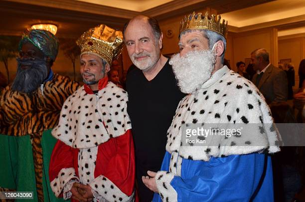 Singer Michel Delpech beetween three 'Kings' attend the 'Charity Event For Children in Haiti' hosted by the CIRA at the Hotel Bristol on January 5...