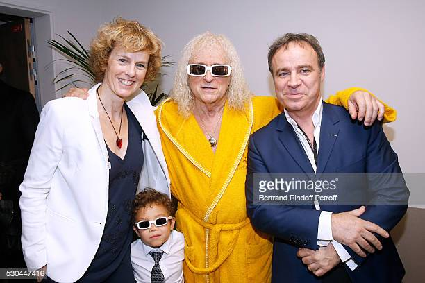 Singer Michel Polnareff and his son Louka standing between autor Fabien Lecoeuvre and his wife actress Anne Richard attend Michel Polnareff performs...