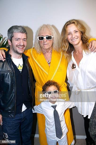 Singer Michel Polnareff and his son Louka standing between singer Gregoire and his wife Eleonore de Galard attend Michel Polnareff performs at Accor...