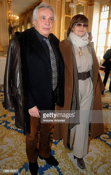 Singer Michel Sardou and AnneMarie Périer attend a ceremony honouring personalities of the arts by French Culture Minister Frederic Mitterrand at...
