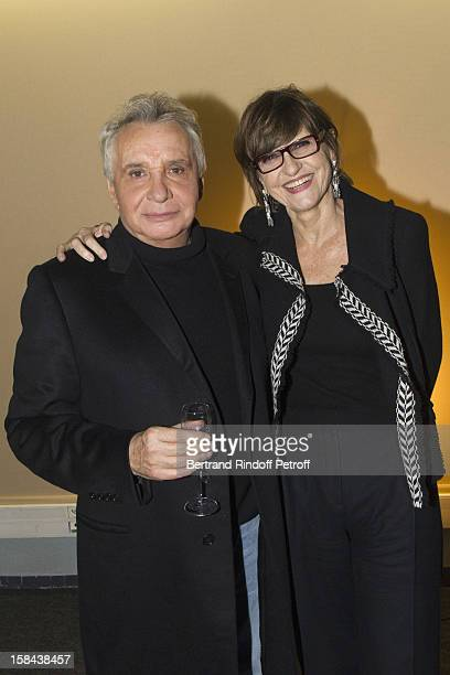 Singer Michel Sardou and his wife AnneMarie Perier pose in Sardou's dressing room following his show at Palais Omnisports de Bercy on December 14...