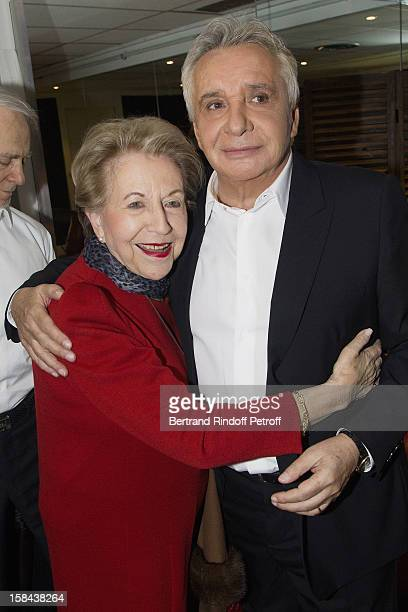 Singer Michel Sardou and legendary songwriter Vline Buggy share a light moment in Sardou's dressing room following his show at Palais Omnisports de...