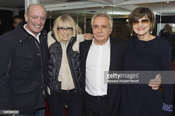 Singer Michel Sardou and Pascal Desprez his wife actress Mireille Darc and Sardou's wife AnneMarie Perier pose in Sardou's dressing room following...