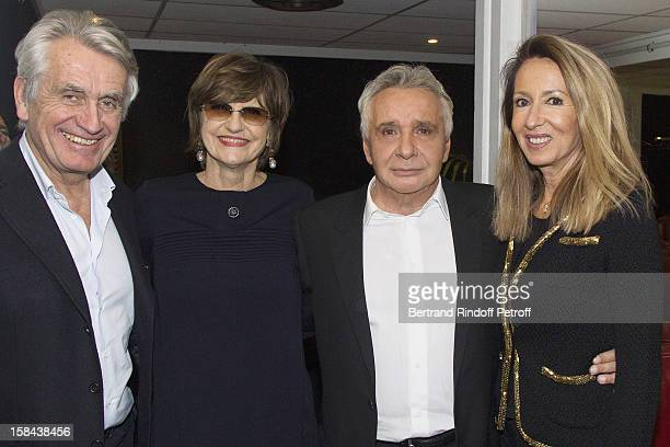 Singer Michel Sardou and show producer Gilbert Coullier Sardou's wife Annemarie Perier and Coullier's wife Nicole pose in Sardou's dressing room...
