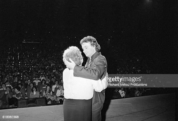 Singer Michel Sardou gives his mother Jackie a hug following his last show at the Palais des Congres in Paris.
