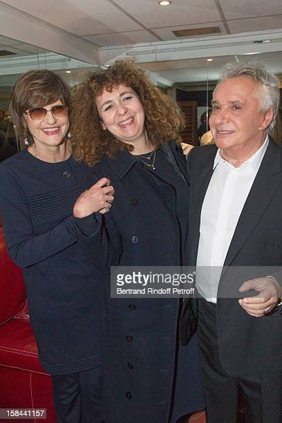 Singer Michel Sardou his wife AnneMarie Perier and Valerie Toranian the EditorinChief of Elle magazine pose in Sardou's dressing room following his...
