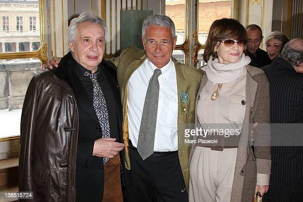 Singer Michel Sardou JeanMarie Perier and AnneMarie Perier attend the 'Personalities Of Design And Photography Honored' ceremony at Ministere de la...