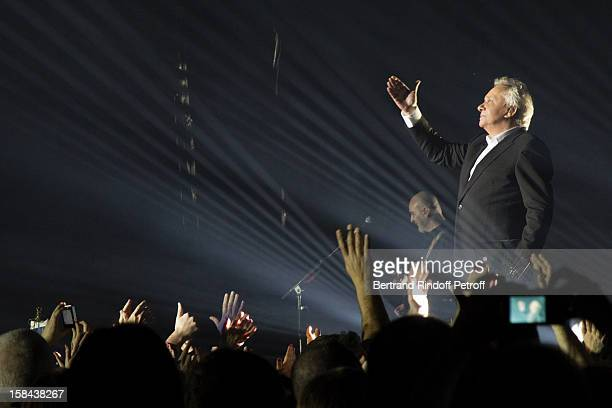 Singer Michel Sardou performs on stage during his show at Palais Omnisports de Bercy on December 12 2012 in Paris France
