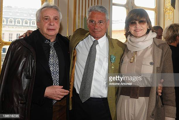 Singer Michel Sardou, Photographer and film director Jean-Marie Périer and Anne-Marie Périer attend a ceremony honouring personalities of the arts by...