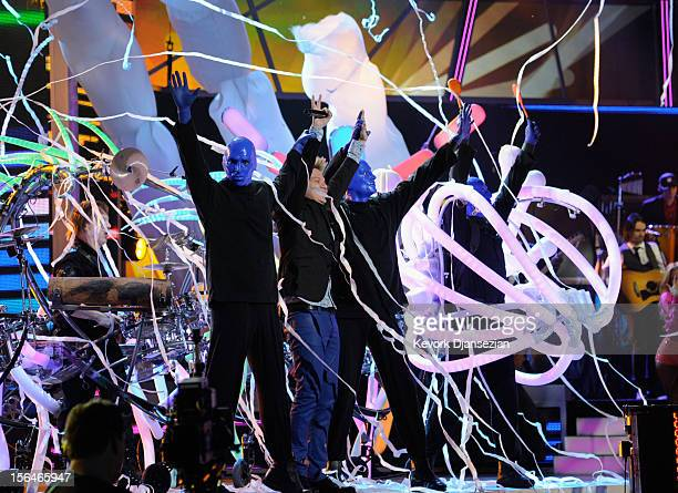 Singer Michel Telo and Blue Man Group perform onstage during the 13th annual Latin GRAMMY Awards held at the Mandalay Bay Events Center on November...