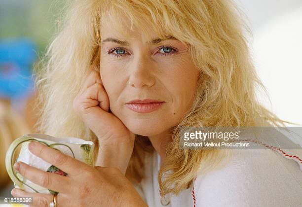 Singer Michele Torr holds a coffee cup at home in StRemydeProvence France