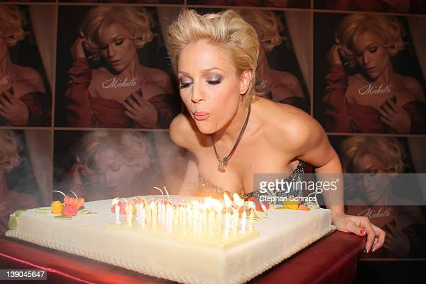 Singer Michelle blowing out candles on her birthdaycake during her 40th birthday party at Claerchens Ballhaus Auguststrasse 24 on February 15 2012 in...