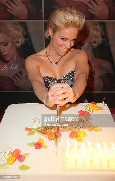 Singer Michelle Cutting Her Birthday Cake During The Celebration Of 40th At Claerchens Ballhaus