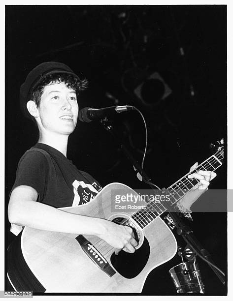 Singer Michelle Shocked performing on stage with his guitar 1989