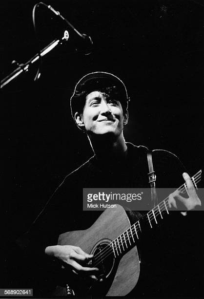 Singer Michelle Shocked performing on stage with his guitar circa 1990