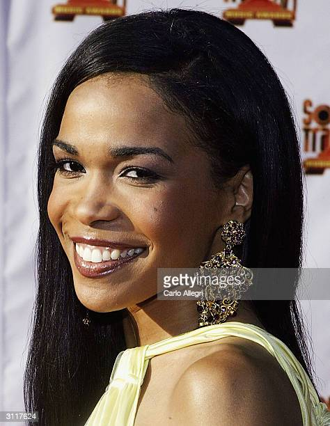 Singer Michelle Williams arrives for the 18th Annual Soul Train Music Awards March 20 2004 in Los Angeles California The Awards were broadcast live...