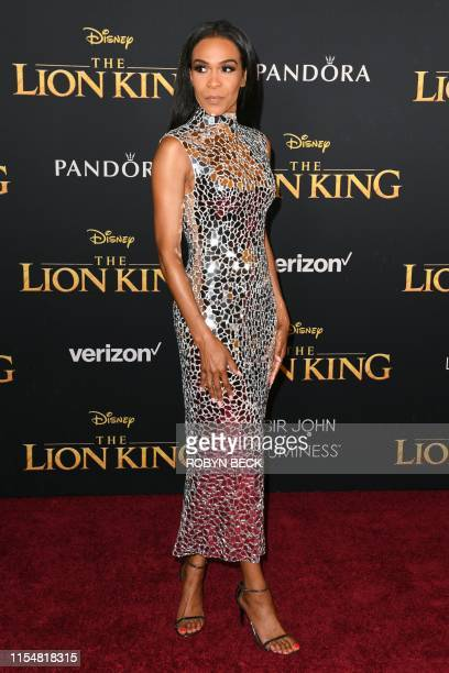 """Singer Michelle Williams arrives for the world premiere of Disney's """"The Lion King"""" at the Dolby theatre on July 9, 2019 in Hollywood."""