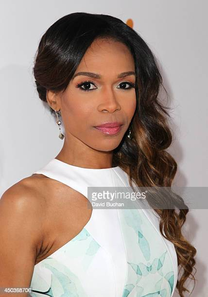 Singer Michelle Williams attends the Premiere Of Screen Gems' Think like a man too at TCL Chinese Theatre on June 9 2014 in Hollywood California