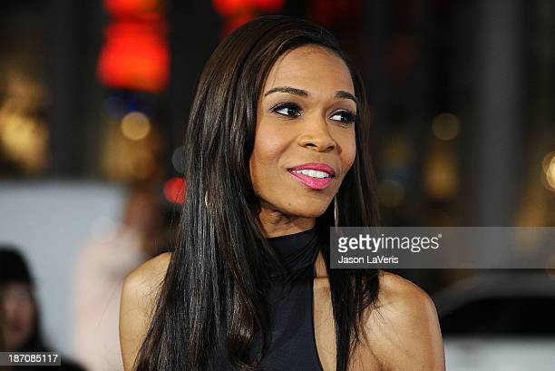 """Singer Michelle Williams attends the premiere of """"The Best Man Holiday"""" at TCL Chinese Theatre on November 5, 2013 in Hollywood, California."""