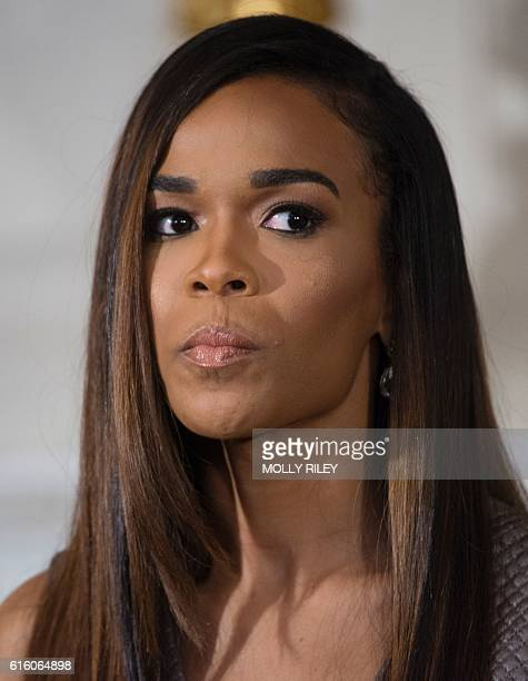 Singer Michelle Williams listens as First Lady Michelle Obama delivers remarks as part of the ongoing series of The GRAMMY Museum musical workshops...