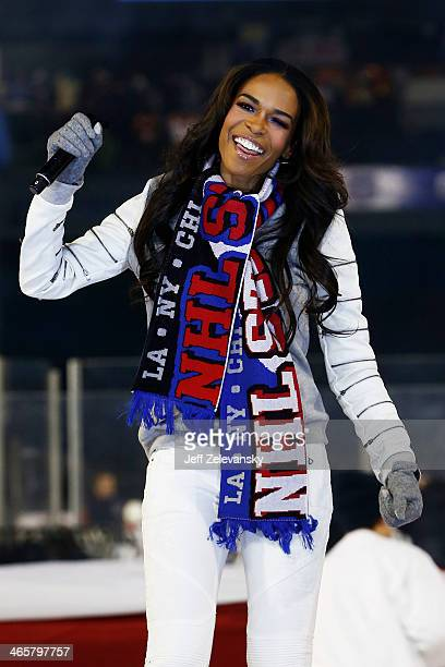 Singer Michelle Williams performs the national anthem prior to the 2014 Coors Light NHL Stadium Series game between the New York Rangers and the New...