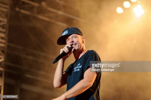 Singer Michi Beck of The band 'Die Fantastischen Vier' performs live on stage during day 3 of the Highfield Festival at Stoermthaler See on August 19...