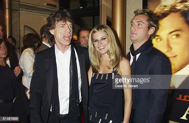 Singer Mick Jagger actress Sienna Miller and actor Jude Law arrive at the World Premiere of 'Alfie' at the Empire Leicester Square on October 14 2004...