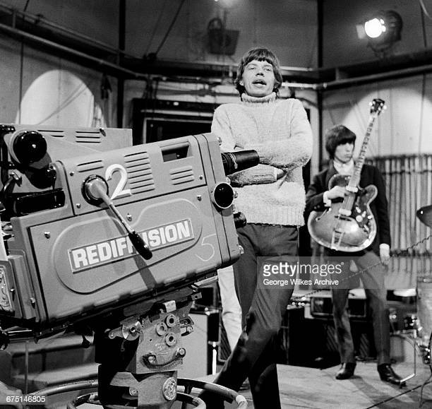 Singer Mick Jagger and bassist Bill Wyman of The Rolling Stones during rehearsals for an episode of the Friday night TV pop/rock show 'Ready Steady...