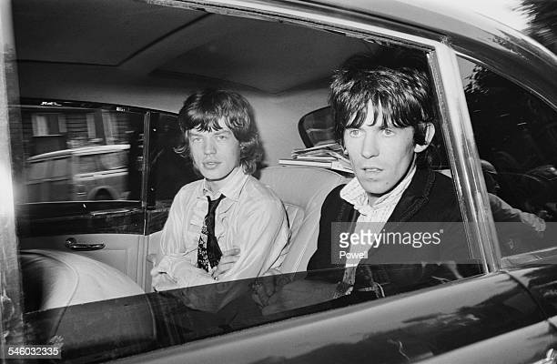 Singer Mick Jagger and guitarist Keith Richards of British rock group the Rolling Stones leaving Wormwood Scrubs prison after being released on...