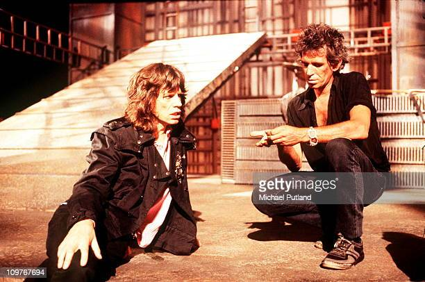 Singer Mick Jagger and guitarist Keith Richards of the Rolling Stones on the set of the music video for 'One Hit ' in England in May 1986