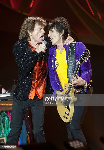 Singer Mick Jagger and guitarist Ronnie Wood of the Rolling Stones perform at Carter Finley Stadium on July 1 2015 in Raleigh North Carolina