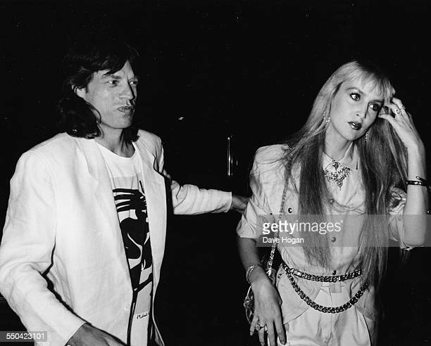 Singer Mick Jagger and his girlfriend model Jerry Hall at a party held by Bob Geldof at the Hard Rock Cafe in London July 25th 1986