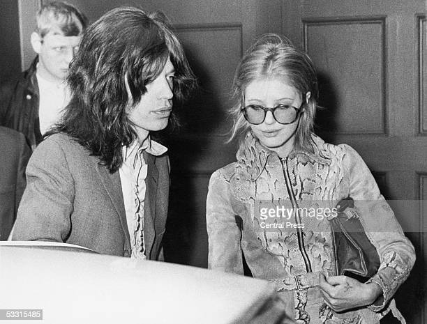 Singer Mick Jagger of the Rolling Stones and his girlfriend Marianne Faithfull arrive at Marlborough Street magistrate's court London 29th May 1969...