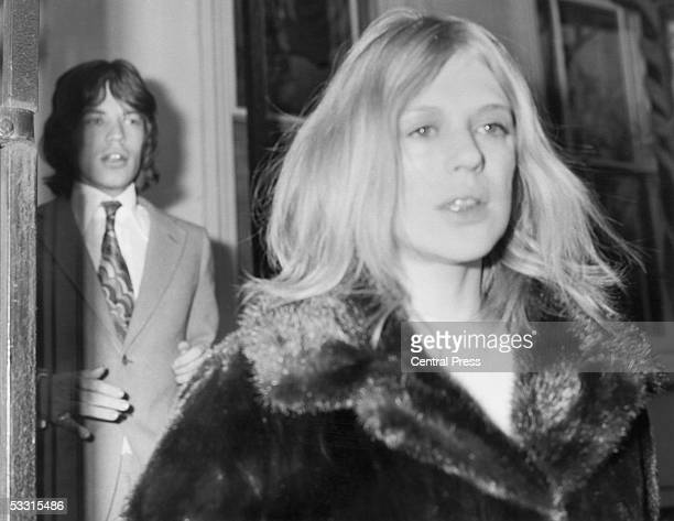 Singer Mick Jagger of the Rolling Stones and his girlfriend Marianne Faithfull on their way to Marlborough Street magistrate's court, London, 18th...